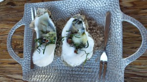 Oysters with kale and housemade bacon.