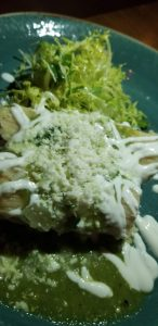 Fresh ground corn masa tamales with green tomatillo salsa and queso fresco