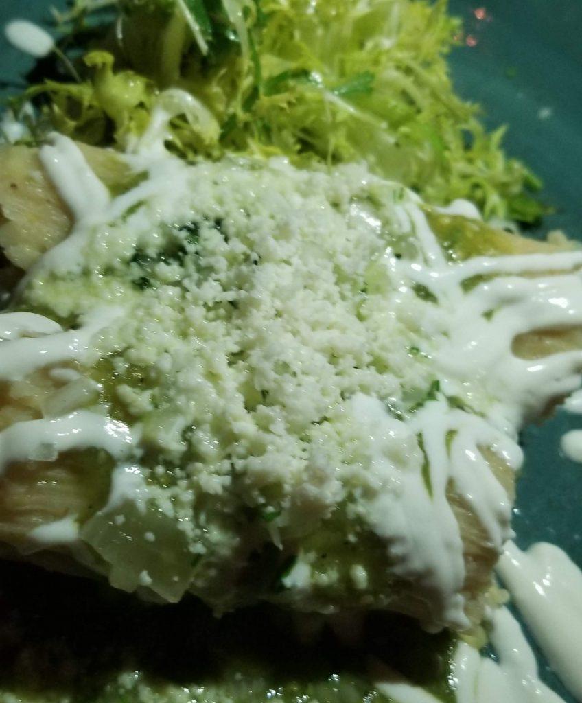 Fresh ground corn masa tamales with green tomatillo salsa and queso fresco