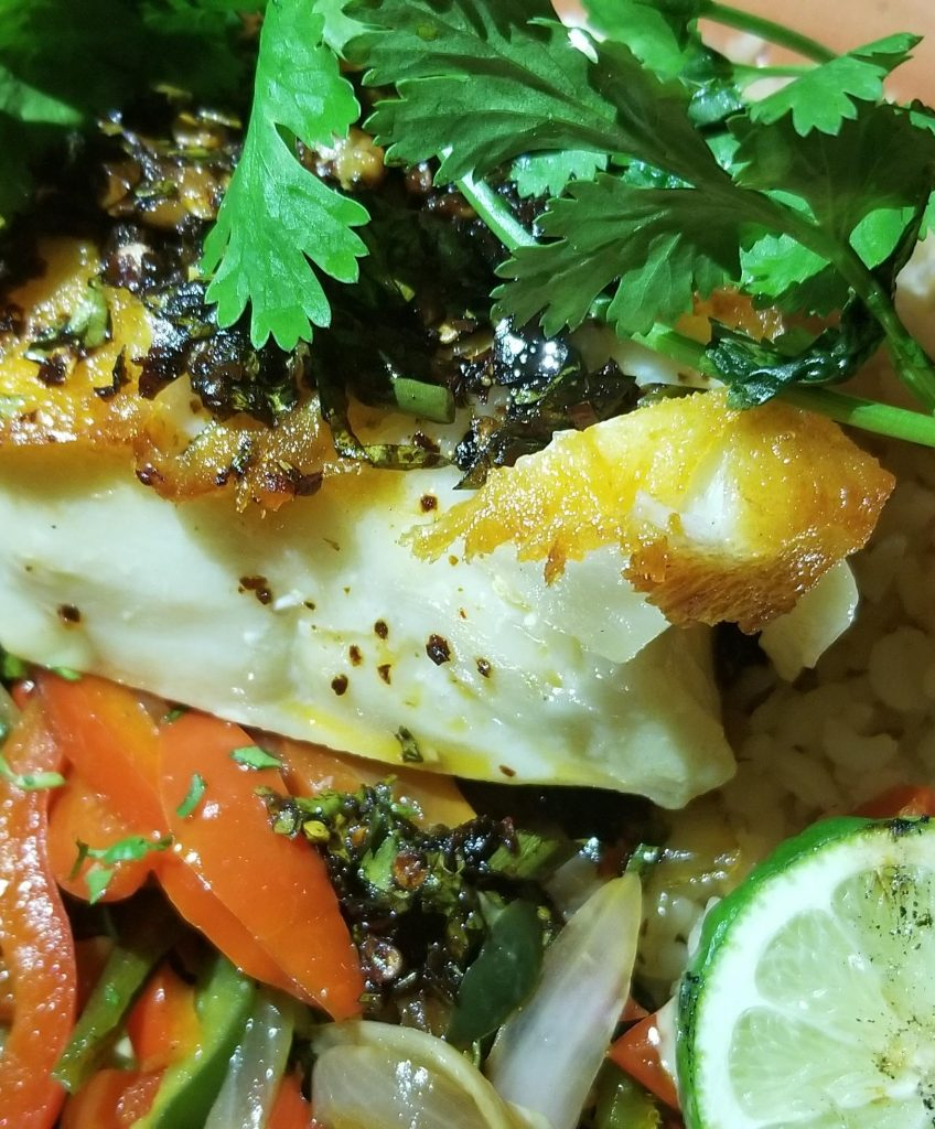 Chilean Sea Bass with Yucatan rice, roasted vegetables, and guajillo chimichurri