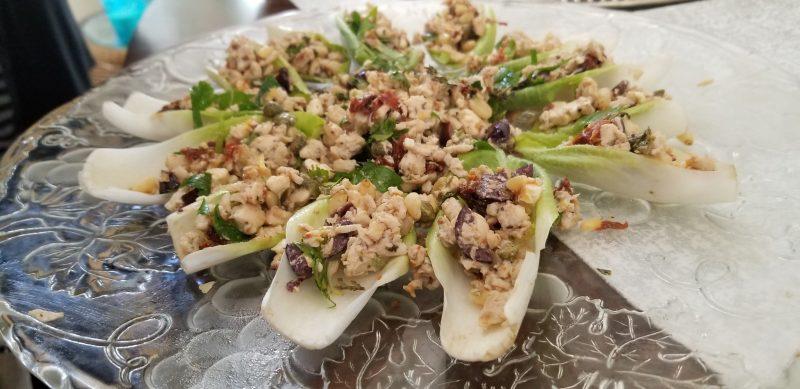 Mediterranean chicken salad on endive lettuce beds