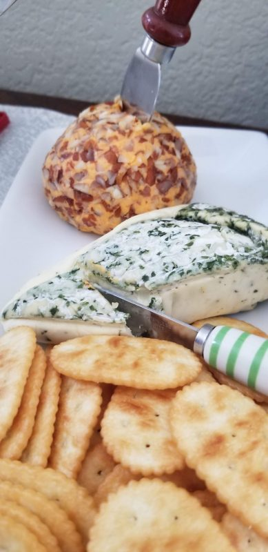 Dill-encrusted Brie and nutty cheddar cheese
