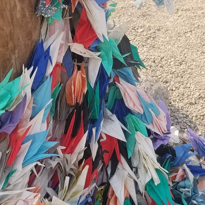 A multitude of origami cranes at the cemetery