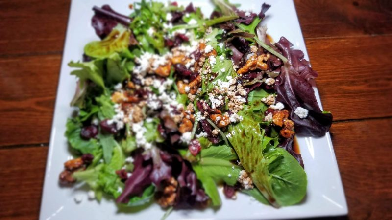 Organic Greens Salad with cranberries and candied nuts