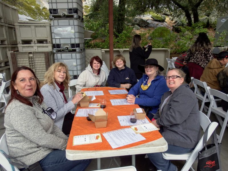 A group of ladies enjoy their wines and tarts at Milagro Winery